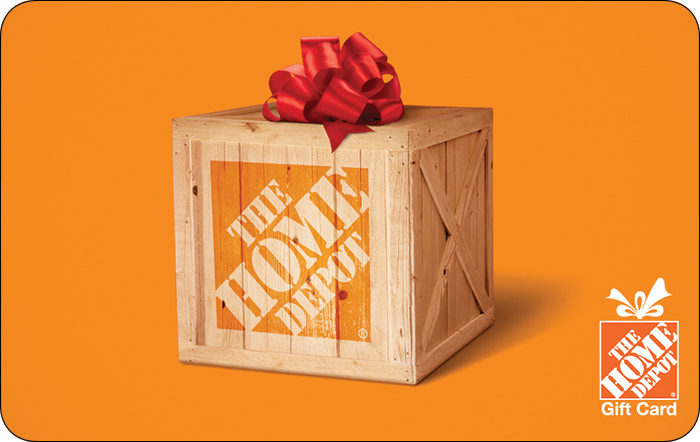 Image of wooden box with The Home Depot logo. The Home Depot logo in bottom right corner of card. Red bow on top of box. Background is orange. Link to The Home Depot gift card purchase details.